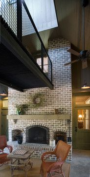 """They 2nd floor walkway spans the """"dog trot"""" entry below and connects the upper levels.  Barn Retreat - Historical Concepts"""