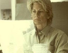 Patricia (Carroll Daniels) Cornwell investigating a coffee and the papers