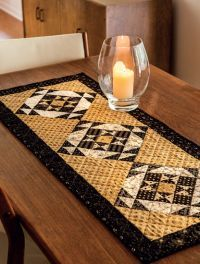 Martingale - Table Toppers  gold, with black and cream star blocks