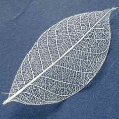 white ink leaf tattoo inspiration