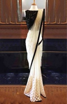 Nylon Mono Net Saree In White And Black Colour White And Black Colour Nylon Mono Net Fabric Party Wear Saree Comes with matching blouse. This Saree Is crafted with Thread Work,Sequins Work This Saree Comes with Unstitched Blouse Which Can Be Stitc. Net Saree Blouse, Black Saree Blouse, Sari Dress, The Dress, Black Net Saree, Black And White Saree, Lace Saree, White White, Fancy Sarees Party Wear