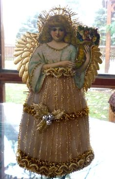 "This beautiful angel will add some ""bling"" to your Victorian Christmas decor this year. Description from etsy.com. I searched for this on bing.com/images"