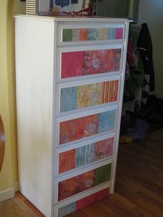 Scrapbook paper and modge podge dresser.  So pretty!
