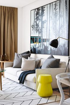 Living room This Melbourne home has broad appeal with a dose of luxury. The Paul Davies artwork is grounded by...