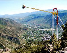 dramatic view of glenwood springs from riders on the Giant Canyon Swing
