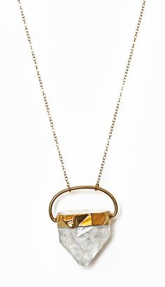 A rock solid addition to your wardrobe (literally!). The big one of a kind raw crystal quartz pendant is adorned with a gold electroplated ring & suspended from a 14k gold filled chain. Measurement: 2