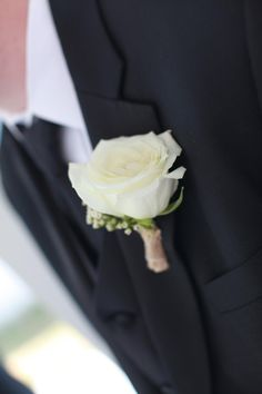 Wedding Flowers - Simple White Boutonniere: White Rose with White Wax Flower accent, wrapped in burlap.  Created by 2 Gals with Flowers, Kansas City, MO