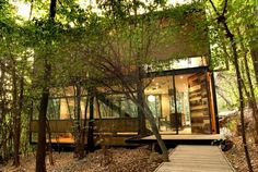 Apollo 11 is a fascinating studio home designed by Parra+Edwards Arquitectos and located in a beautiful forest in La Reina, Santiago, Chile.