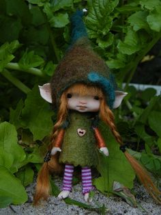 I've been sculpting faeries for my garden this summer. This one is really cute, though!