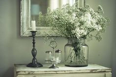 Love this vignette using mismatched and shabby chic items. Love the mirror behind everything and the white flowers in the glass container. Babies Breath, Vintage Colors, Wall Color, Decorating Ideas, Paint Colors, Farmhouse Style, Flower, Vintage Finds, Babi Breath