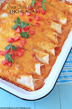 You'll love these Cream Cheese Chicken Enchiladas, smothered in a delicious, bubbling sour cream sauce. It's the perfect Mexican dinner recipe to have with your family!