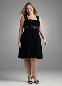 Short jersey dress has beautiful embellishment on the straps and waist.  Style for any occasion.  Back Zip. Fully Lined. Hand Wash Cold.  $59.99