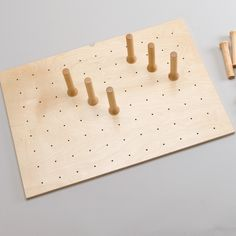 Rev-A-Shelf 4 Extra Pegs For Drawer Peg System 4DPS-PEG-4  | With this endlessly changeable pegboard system you can create instant storage for organizing all kinds of items from dinner plates to plastic storage. |  Order Today! Shop and Save @ CabinetParts.com