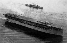 USS Langley (CV-1), America's first aircraft carrier.  Found at http://www.aerospaceweb.org/question/hydrodynamics/q0226.shtml