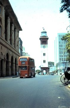 Lighthouse Clock Tower amidst rickshaws & double decker buses in the old city centre of Fort, Colombo, Ceylon as it was seen on 12th April 1966. Photo Credits – Gerhard Lehner