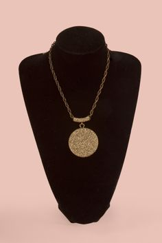 Short Pewter Necklace with one gold circular stone emellishment. This necklace will dress up any outfit. www.brillantezza.com