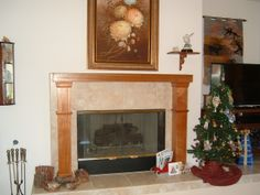 This 30 year old fireplace mantel was reclaimed with the help of a couple of mahogany half-column pilasters. Fireplace Surrounds, Fireplace Mantels, Wood Columns, Cladding, The Help, Smooth, African, Couple, Architecture