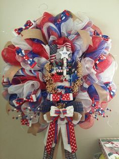 Patriotic decomesh wreath  I made,  it also has 40 white lights.  I also am posting a pic of the center display a little closer up!