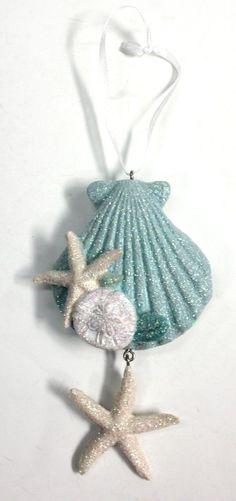 http://www.caseashells.com/scallop-starfish-sanddollar-resin-ornament-4-pieces/