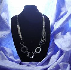 A Little of Everything - this necklace a little of it all - silver tone links in different gauges - black tone links - multi colored bead hoops frame a crystal accent center piece - if you like to be unique and stand out from the crowd, this is for you! $25 #uniquejewelry #statementnecklace  https://www.facebook.com/Amethyst.Orchid.Jewelry/photos/pcb.1521749838043207/1521749374709920/?type=1&theater