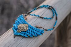 "With an ethnic aspect you may rapidly recognise, this splendid necklace has been created with the well-known macrame technique. Furthermore, it is a 100% handmade accessory. I have called it ""Angkor necklace"" because I have taken inspiration from the architectonic shapes of this ancient city of temples, in Cambodia. This sample is electric blue, but if you would like to have one in another colour, you can order it without any problem and I will go for it. Moreover, it contains beads and an…"