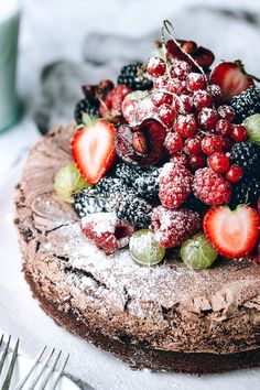 Chocolate Meringue Cake with Fresh Berries via Artful Desperado - Rich Chocolate Cake with a layer of chocolate meringue baked on top.