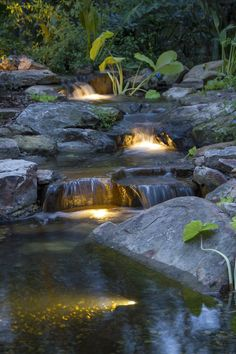Garden Design Cascading backyard waterfall lit up at night! - With today's busy lifestyle, it can be difficult to enjoy your pond during the day. Underwater lights create a whole new experience by your pond after the sun goes down.