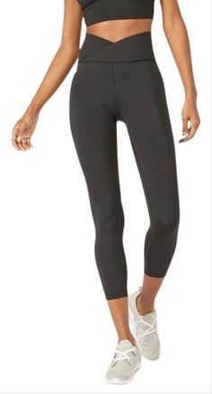 "You have officially come across the perfect workout/yoga legging With the stylish wrap front waistband & moisture wicking technology, you'll stay dry & comfortable while enjoying ultimate comfort & mobility * mid-rise * hem at mid-calf * wrap front waistband * 2 way stretch * moisture wicking technology * black in color * 83% polyester | 17% spandex * inseam 21"" * machine washable * NWT * MSRP $42.95 