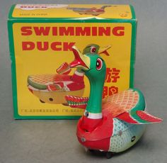 """Circa the 1970's, this wind up duck travels forward while """"quacking"""". About 6 inches tall and 4.5 inches long, it is a very large and nicely lithographed tin toy! Expect some box crushing from storage"""