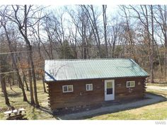 Cabin on Brush Creek in Cuba. Approximately quarter mile of Brush Creek frontage with 9 acres m/l. Property is fenced, 10' x 10' shed, horse barn with workshop, surround this quaint 2 bedroom, 1 bath cabin. Included in this great price, comes a 1950s tractor with attachments, tools in the workshop, lawn mower, ATV, two small trailers, appliances as well as beds, living room and dining room furniture, as well as linens and dishes in the cabinets. This is move in ready, and then some! in Cuba…