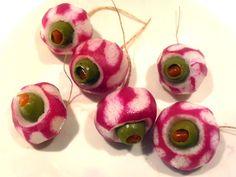 Zombie Eyeball Martini (olives stuffed into peeled radishes for garnish): Gin, Vermouth, Radishes, Pimento-stuffed Olives