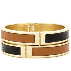 Set of two hinge bangles with chain and exotic faux leather detail. Material: Faux Leather, Metal.