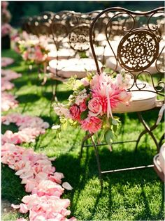 Pink chair flowers and petals for a garden wedding #chair #aisle #decor
