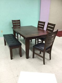 Modern expanding family, deep tones, relationship building Table and chairs with bench
