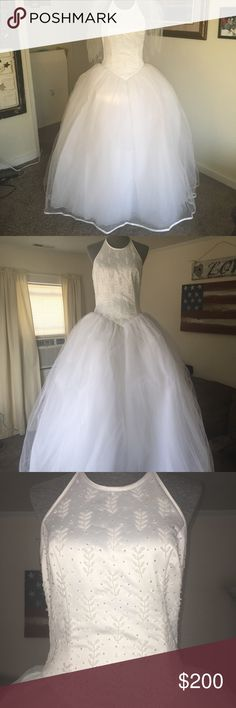 Wedding Ball Gown 💍 🎀 Beautiful full tulle ball gown style dress with ribbon hem. Size 10-12. Bustled in back and back bottom tulle fixed due to small rip when on the dance floor. Halter style bodice with beading. Veil included with Velcro attached hair price for easy removal after ceremony. Please ask any questions. Pallas Athena Dresses Wedding