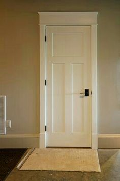 Craftsman Interior Door Trim Style In Stained Wood And Square Hardware