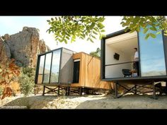 Friends turn vacant zoo on rocky hill into hotel of glass pods - YouTube