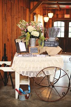 Chic vintage ranch wedding decor - not the full set up but thought some of the ideas on the table are cute.especially the sparklers Wedding Entry Table, Gift Table Wedding, Wedding Guest Book, Rustic Wedding, Reception Table, Wedding Guestbook Table, Guestbook Ideas, Wedding Dj, Farm Wedding