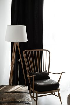 Lamp DIY made from old camera and wooden tripot. Ercol airmchair from 60s.