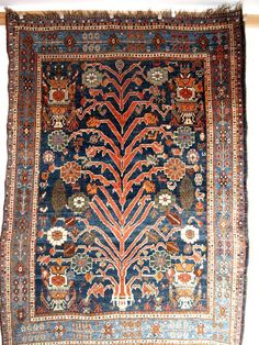 Qashqai / Luri 'tree of life' soft floppy handle, long glossy wool. Size: 8ft x 5ft.