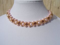 This piece is inspired from my love of vintage collars.    There are three rows of 6-8mm glass pearls in blush pink and intermittent 8mm