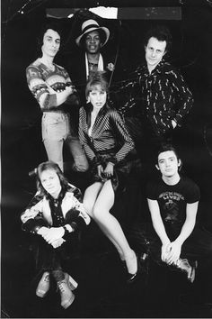 """SHARKS (mkII) w/NORA FOSTER - 1974. Wonder Workshop &  Let it Rock! Nora Foster's daughter ARI UP co-founded THE SLITS & she's partners w/JOHNNY ROTTEN.  Nick Judd(in Wonder Workshop jacket), Marty Simon, Busta """"Cherry"""" Jones, CHRIS SPEDDING in """"Let It Rock Rock N Roll Lives/Chuck Berry T"""" Photo by DICK POLAK. WONDER WORKSHOP design by MOLLY WHITE & JOHN DOVE + LET IT ROCK design by VIVIENNE WESTWOOD & MALCOM McLAREN."""