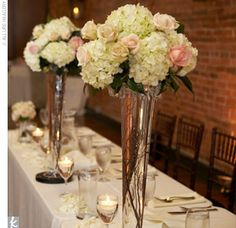 i love these tall arrangements for the church with green hydrangeas then with hot pink roses