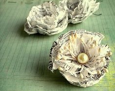Tissue Paper flowers. And how cute to make out of old sewing patterns.