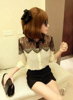 Black lace yoke over ivory bodice blouse ... would look great with some leopard heels and black ankle pants!