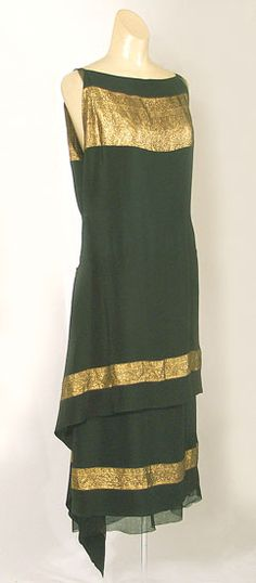 Callot Soeurs dress of black silk with bands of gold lamé, ca.1924.