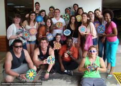 Students in the FLLT in Costa Rica program show off their hand painted oxcart wheels.