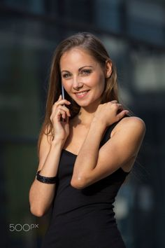 Attractive young elegant girl in black dress with phone on her hand. Elegant Girl, Black, Phone, Dresses, Gowns, Black People, Telephone, All Black, Dress