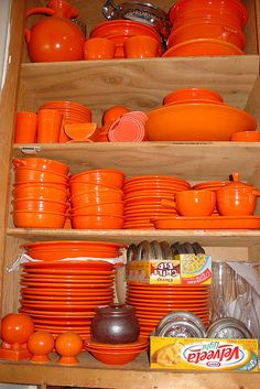 "Collection of early 70's Orange kitchen & serve-ware, including ""Melamine"" & Tupperware (plastics), Fiesta Ware, & painted glass."