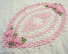 orchid pink and ecru roses oval centerpiece doily